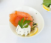 Finger food with smoked salmon — Stock Photo