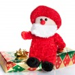 Colorful gift boxes with Santa Claus puppet — Stock Photo