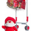Shopping cart with Christmas gifts — Stock Photo
