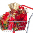 Stock Photo: Shopping cart with Christmas gifts