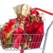 Shopping cart with Christmas gifts — Stock Photo #34060363