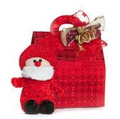 Rote geschenktüte mit santa claus marionette — Stockfoto