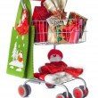 Shopping cart full of Christmas gifts — Stock Photo