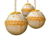 Homemade christmas balls coated with golden fabric. — Stock Photo