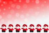 Row of puppets of Santa Claus on a red background with snow — Stock Photo