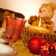 Stock Photo: Table with candle for Christmas dinner