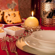 Table decorated for Christmas dinner — Stock Photo #34376203