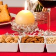 Pine nuts, almonds and hazelnuts in bowls on the Christmas table — Stock Photo