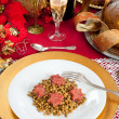 Pig trotter star shaped with lentils over christmas table — Stock Photo #34478845