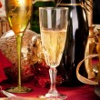 A Glass of Champagne on a decorated Christmas day dinner table — Stock Photo