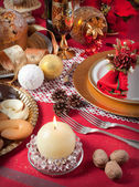 Christmas table near the fireplace — Stock Photo