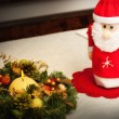 Christmas centerpiece with candle and bottle as Santa Claus — Foto Stock