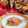 Slices of pig trotter with lentils over christmas table — Stock Photo #34490445