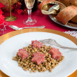 Stock Photo: Pig trotter star shaped with lentils over christmas table
