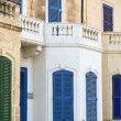 Blue Window and balcony on ancient wall Mediterranean, Malta — Stock Photo