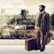 Emigrant to the train station with cardboard suitcases — Stock Photo