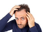 Man controls hair loss — Stock Photo
