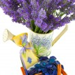 Stock Photo: Watering can with lavender sachet