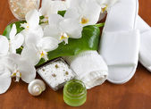 Spa accessories on wooden table — Stock Photo
