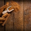 Stock Photo: Frame with sticks and ground ceylon cinnamon