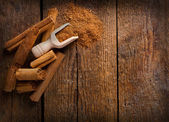 Frame with sticks and ground ceylon cinnamon — Stock Photo