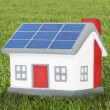 House model plastic with solar panels — Stock Photo