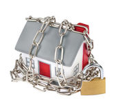 House model plastic with chain and padlock — Stock Photo