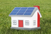 House model plastic with solar panels — Stock Photo