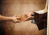 Jesus gives the bread to a beggar. — Stock Photo