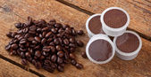 Coffee pods on wooden table — Stock Photo