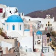 Traditional landmarks with blue cupola in Santorini — Stock Photo