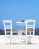 Two white chairs in santorini — Stock Photo