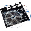 Stock Photo: Retro film reel with ciak