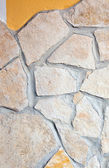 Wall lined with porphyry stones — Stock Photo