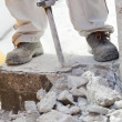 Stock Photo: Worker demolishing concrete with jackhammer