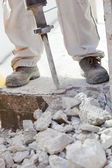 Worker demolishing the concrete with a jackhammer — Stock Photo