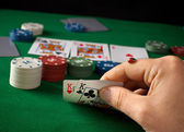 Ladybug on hand during a poker game — Stockfoto