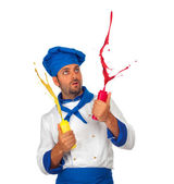 Chef plays with ketchup and mayonnaise — Stock Photo