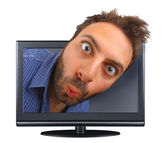 Young boy with a surprised expression in the tv — Photo