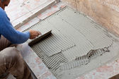 Tiler to work with tile flooring — ストック写真
