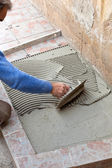 Tiler to work with tile flooring — Stock Photo