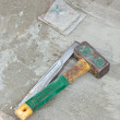 Stock Photo: Awl and hammer on concrete flooring