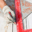 Stock Photo: Mmeasuring tile piece with pencil