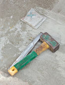 Awl and hammer on concrete flooring — Stock Photo