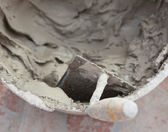 Trowel and cement — Stock Photo