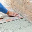 Tiler to work with tile flooring — Stock Photo #40595055