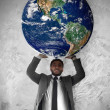 Young businessman sustains the planet Earth — Stok fotoğraf