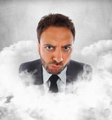 Young businessman in the clouds with expression of indecision — Stock Photo