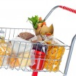 Shopping cart full with food products — Stock Photo