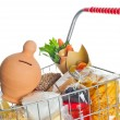 Shopping cart full with money box and food products — Stock Photo #41647979